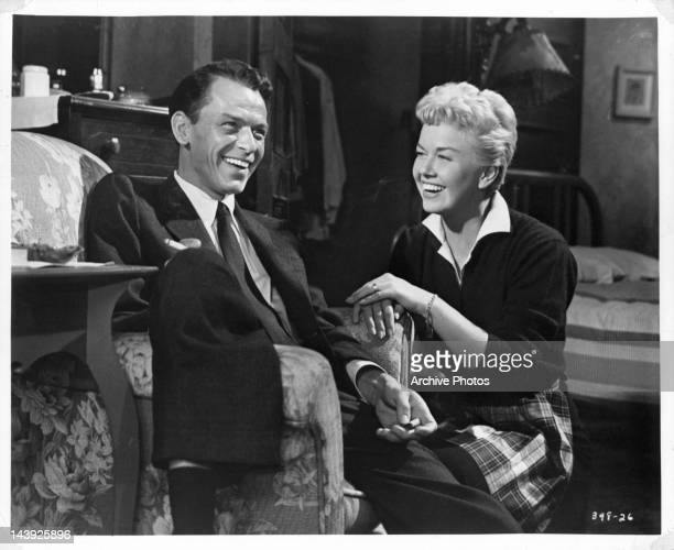 Frank Sinatra and Doris Day sharing a laugh in a scene from the film 'Young At Heart' 1954