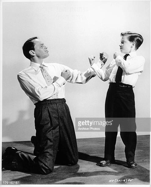 Frank Sinatra And Eddie Hodges with fists up to fight in a scene from the film 'A Hole In The Head' 1959