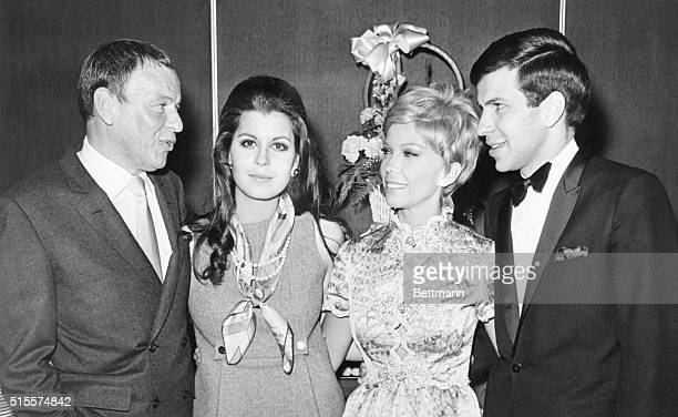 Frank Sinatra and his children Tina Nancy and Frank Jr at the singer's 53rd birthday in Las Vegas