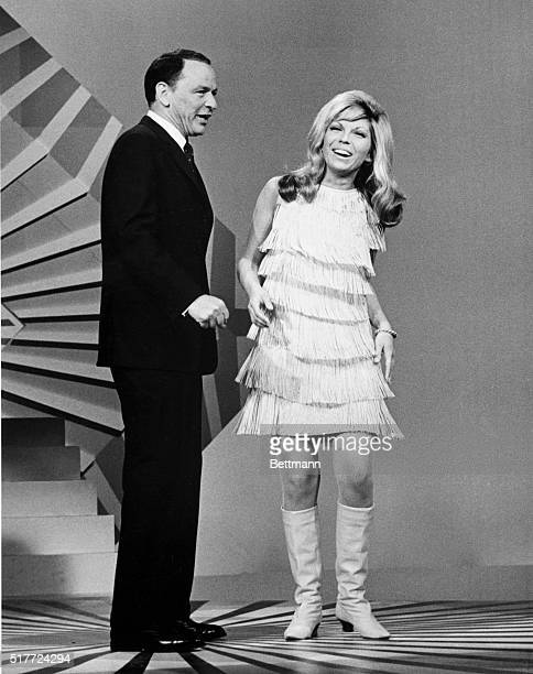 Frank Sinatra and his daughter Nancy Sinatra perform on the television special 'A Man and His Music' Nancy's trademark song was 'These Boots Are Made...