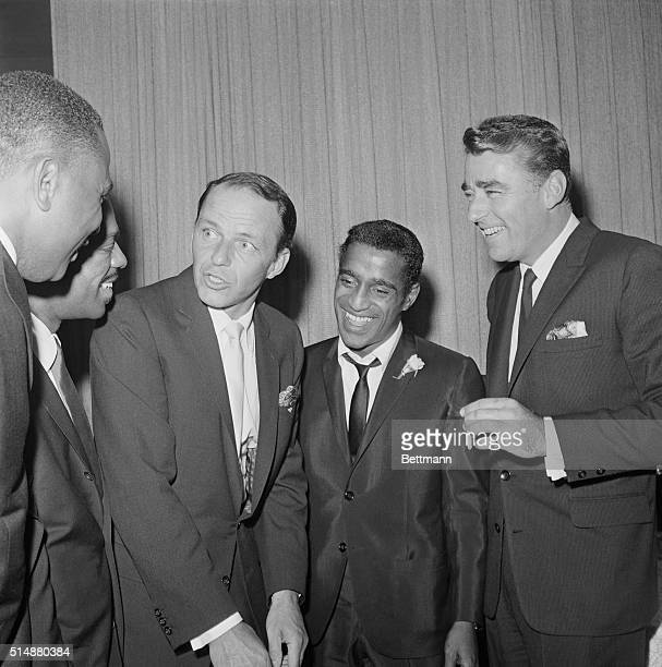 Frank Sinatra and Peter Lawford at Sammy Davis Jr's wedding to Mae Britt The groom is in the center