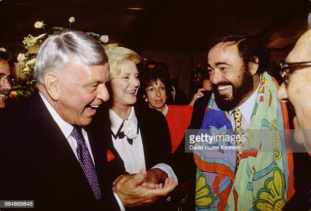 Frank Sinatra Barbara Sinatra and Luciano Pavarotti chat after The Three Tenors concert at Dodger Stadium July 16 1994 in Los Angeles The concert is...