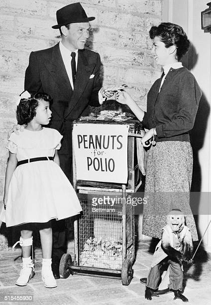 Frank Sinatra buys the first bag of Peanuts for Polio from his 15 year old daughter Nancy who represents over a million teenagers selling peanuts...
