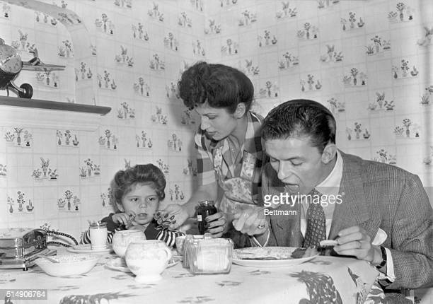 Frank Sinatra eating breakfast with his daughter Nancy while his wife Nancy brings the jam Undated photo