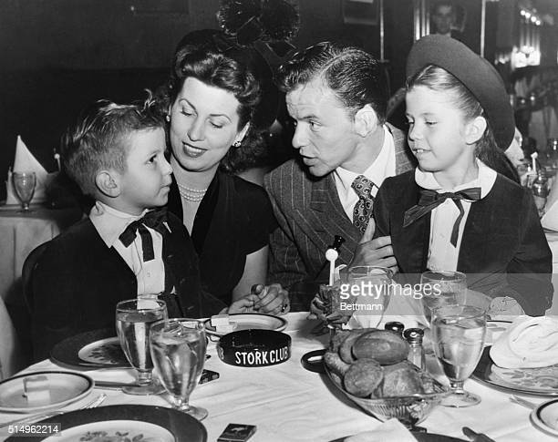 Frank Sinatra Entertains Family at Stork Club New York New York New York Sinatra takes time out to entertain his wife and youngsters Nancy and...