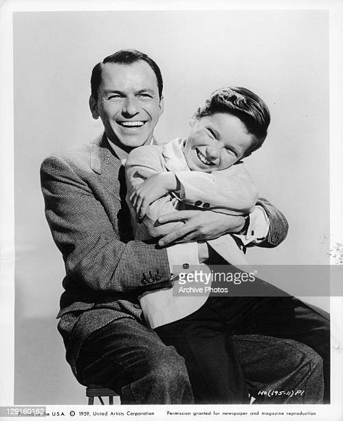 Frank Sinatra holding Eddie Hodges laughing in a scene from the film 'A Hole In The Head' 1959