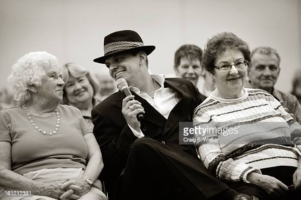 Frank Sinatra impersonator, Derek Evilsizor performs for Mary Collett, left, and Zana Goldenberg at the 22nd Annual Salute to Senior, presented by...