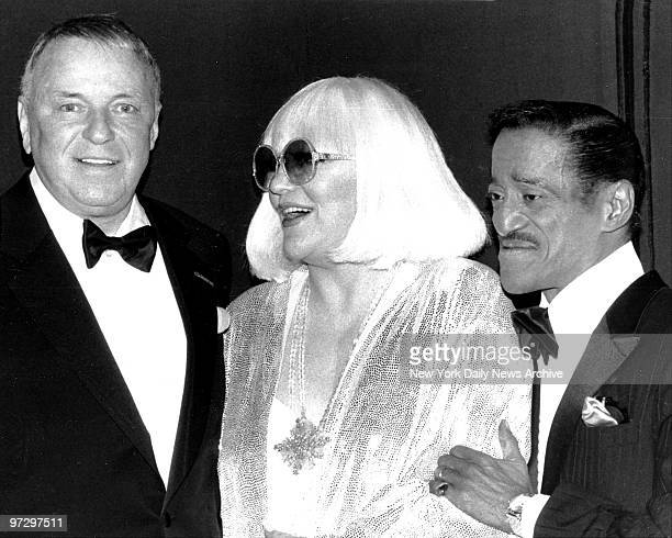 Frank Sinatra is brighteyed and bushytailed backstage at Radio City Music Hall as he welcomes Peggy Lee and Sammy Davis Jr for Sinatra VII Ol' Blue...