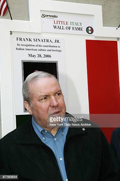 Frank Sinatra Jr stands in front of his display as he becomes the first person to be inducted into the Little Italy Wall of Fame outside the Most...