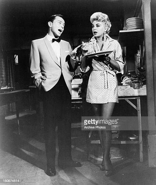 Frank Sinatra looking over at Barbara Nichols in a scene from the film 'Pal Joey' 1957