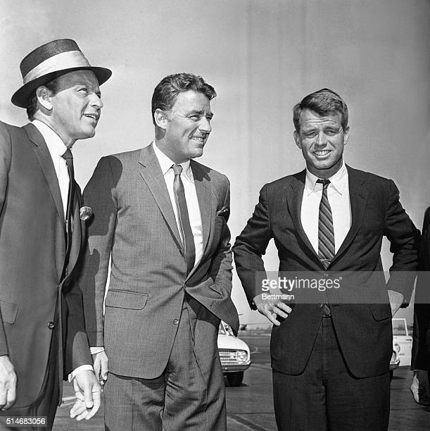 Frank Sinatra Peter Lawford and Robert Kennedy wait for a helicopter to take them to a charity fundraising dinner for a hospital in Los Angeles July...