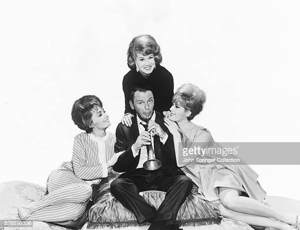 Frank Sinatra Playing a Horn for Three Women