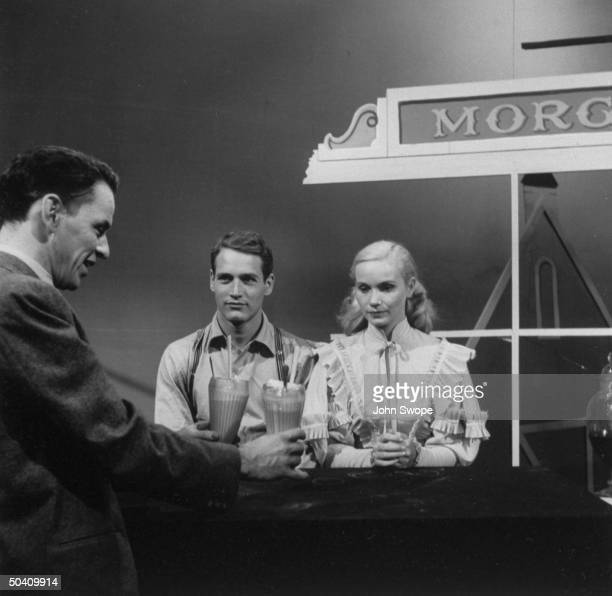 Frank Sinatra serving ice cream sodas to Paul Newman and Eva Marie Saint in television production of Our Town