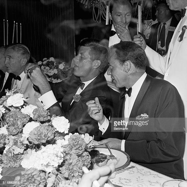 Frank Sinatra sits next to Senator John F. Kennedy at a fund-raiser, on the eve of Kennedy's selection as the Democratic Presidential nominee. Los...