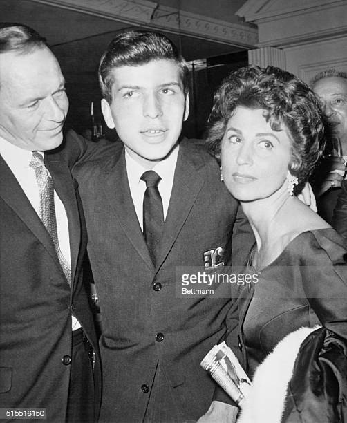 Frank Sinatra Sr SingerActor with his exwife Nancy embraces his son Frank Jr after he made his Los Angeles singing debut at the Cocoanut Grove...