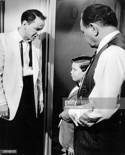 Frank Sinatra talks with Eddie Hodges in a scene from the film 'A Hole In The Head' 1959