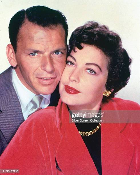 Frank Sinatra US singer and actor and his wife US actress Ava Gardner posing cheektocheek in a studio portrait against a white background circa 1953...