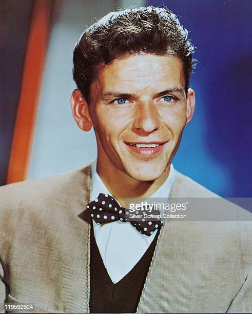 Frank Sinatra , US singer and actor, wearing a black bow tie with white polka dots in a studio portrait, circa 1945.