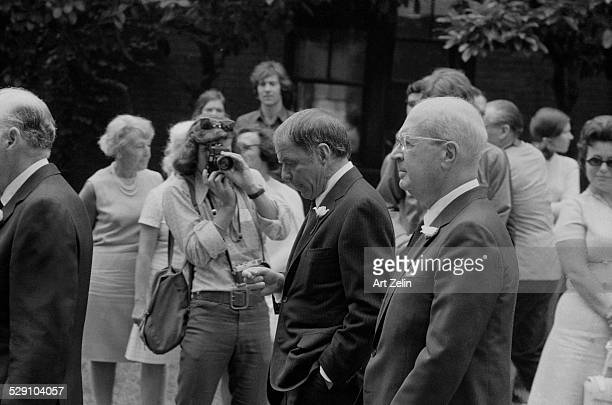 Frank Sinatra walking with Jilly Rizzo at Bennett Cerf's funeral 1971