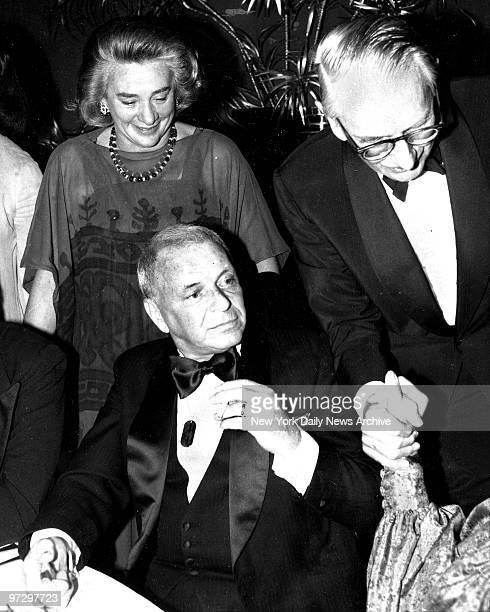 Frank Sinatra with Happy Rockefeller and Laurance Rockefeller at Doubles Restaurant