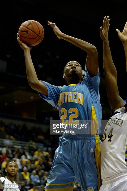 Frank Snow of the Southern Jaguars drives to the hoop during the game against the Marquette Golden Eagles at BMO Harris Bradley Center on November 08...