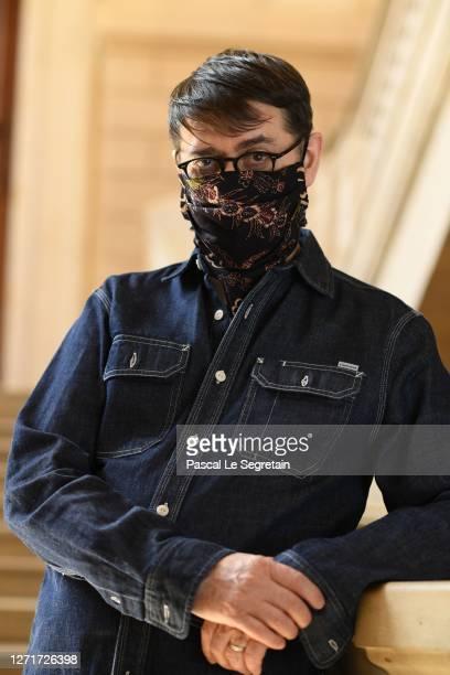 "Frank Sorbier, french fashion designer and Maître d' Art, wears a Franck Sorbier batik pattern Gavroche-mask and poses for the ""Il Medico Della..."