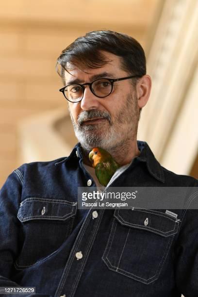 "Frank Sorbier, french fashion designer poses with his parrot ""Love"" for the ""Il Medico Della Peste"" 2020/2021 Winter Franck Sorbier Haute Couture..."