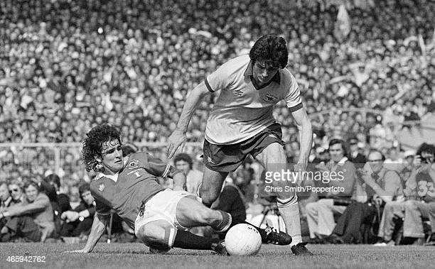 Frank Stapleton of Arsenal is tackled by Arthur Albiston of Manchester United during the FA Cup Final at Wembley Stadium in London on 12th May 1979...