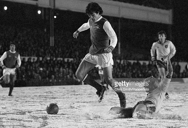 Frank Stapleton of Arsenal is tackled in the snow during the Arsenal v Norwich City Division One football match at Highbury London on 21st December...