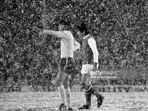 Frank Stapleton of Arsenal with an unidentified Norwich City defender as the snow falls during the Arsenal v Norwich City Division One football match...