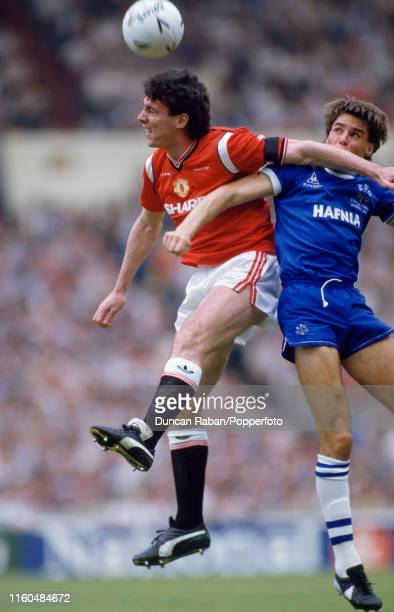 Frank Stapleton of Manchester United heads the ball under pressure from Pat Van Den Hauwe of Everton during the FA Cup Final at Wembley Stadium on...