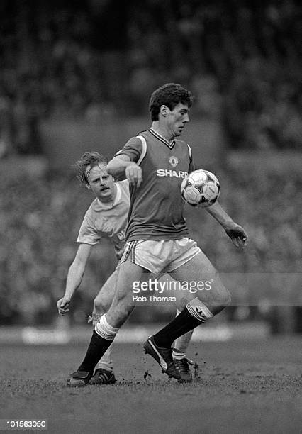 Frank Stapleton of Manchester United shields the ball from Neil McNab of Manchester City during the Division One match held at Old Trafford on 22nd...