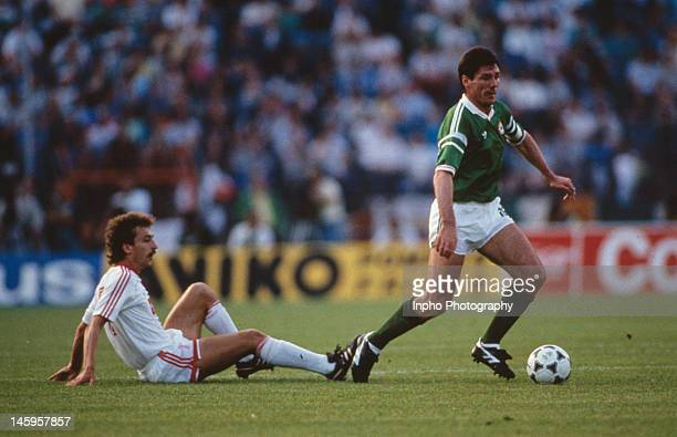 Frank Stapleton of Republic of Ireland takes the ball past Sergei Aleinikov of USSR during the UEFA European Championships 1988 Group 2 match between...