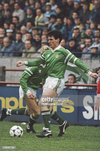 Frank Stapleton of the Republic of Ireland prepares to pass the ball during an International match in Dublin Ireland in 1988