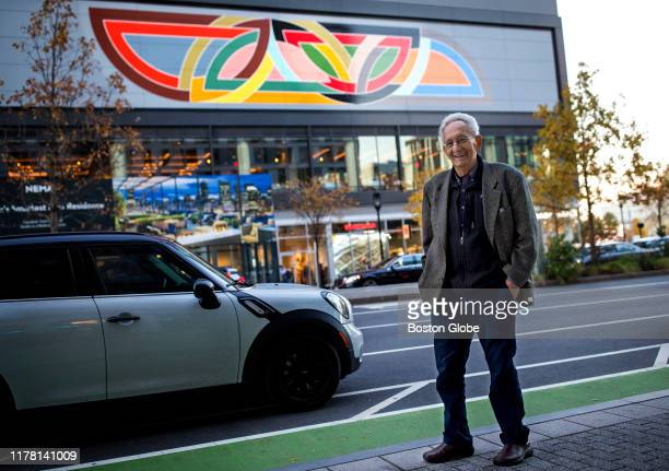 Frank Stella poses in front of his mural reproduction of his 1970 painting Damascus Gate along Seaport Boulevard in Boston on Oct 24 2019