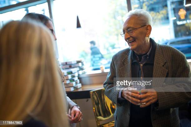 Frank Stella talks with guests during the reception at Yotel Boston for his mural reproduction of his 1970 painting Damascus Gate along Seaport...
