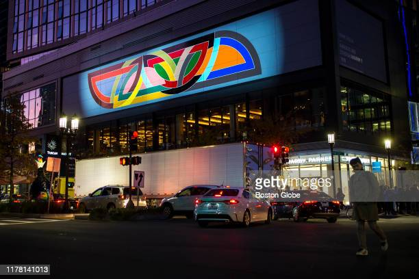 Frank Stella's mural reproduction of his 1970 painting Damascus Gate is lit up along Seaport Boulevard in Boston on Oct 24 2019