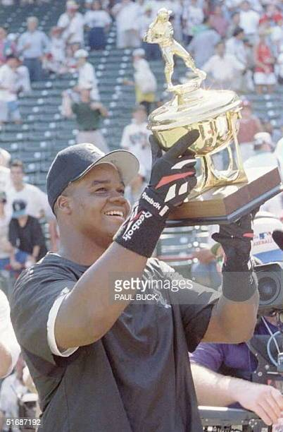 Frank Thomas of the Chicago White Sox hoists his trophy after winning the All-Star Game home run contest 10 July at The Ballpark in Arlington, Texas....