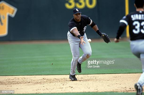 Frank Thomas of the Chicago White Sox tosses a ball to the pitcher covering first base during a 2000 season gameagainst the Oakland Athletics at...