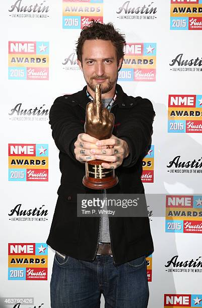 Frank Turner poses after picking up the Outstanding Contribution to Music award on behalf of the Tennage Cancer Trust in the winner's room at the NME...