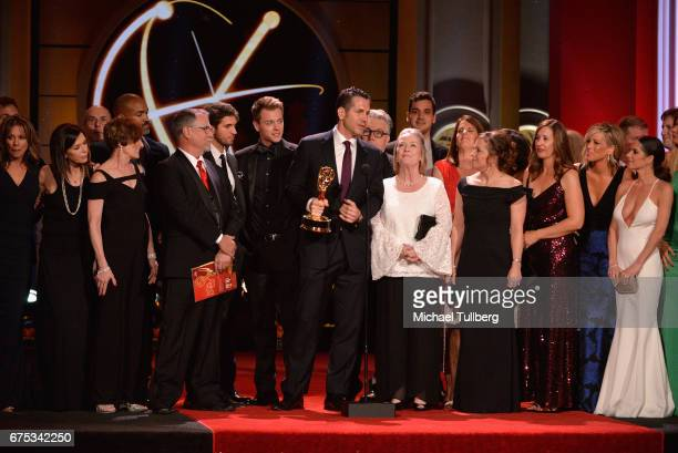 Frank Valentini center and the cast and crew of 'General Hospital' accept the award for outstanding drama series at the 44th annual Daytime Emmy...
