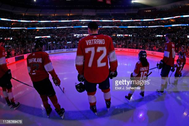 Frank Vatrano and Aleksander Barkov of the Florida Panthers stands on the ice with junior skaters for the national anthem prior to the start of the...