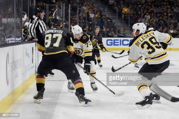 Frank Vatrano and Matt Beleskey of the Boston Bruins battle for the puck with Vadim Shipachyov of the Vegas Golden Knights during the game at TMobile...