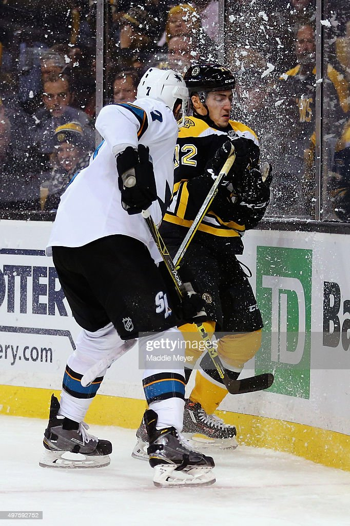 Frank Vatrano #72 of the Boston Bruins is checked into the boards by Paul Martin #7 of the San Jose Sharks during the third period at TD Garden on November 17, 2015 in Boston, Massachusetts. The Sharks defeat the Bruins 5-4.