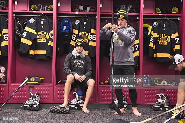 Frank Vatrano of the Boston Bruins prepares his stick in the locker room prior to the 2016 Bridgestone NHL Classic against the Montreal Canadiens at...