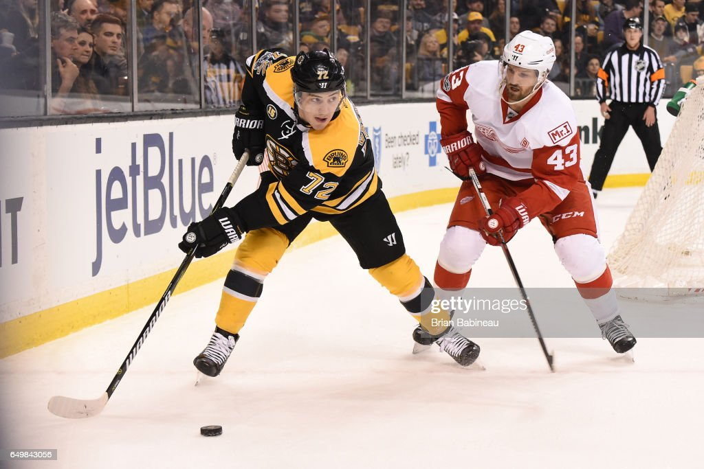 Frank Vatrano #72 of the Boston Bruins skates against Darren Helm #43 of the Detroit Red Wings at the TD Garden on March 8, 2017 in Boston, Massachusetts.