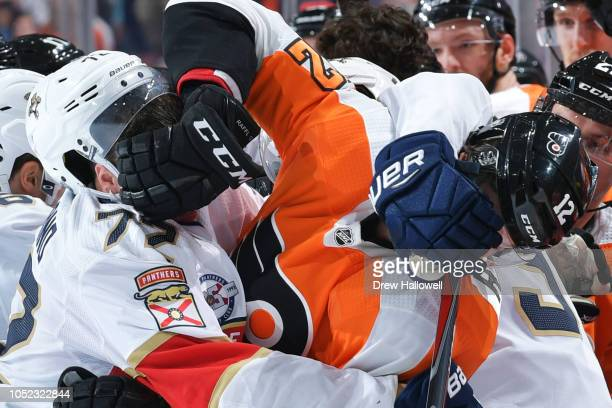 Frank Vatrano of the Florida Panthers and Michael Raffl of the Philadelphia Flyers mix it up at the Wells Fargo Center on October 16 2018 in...