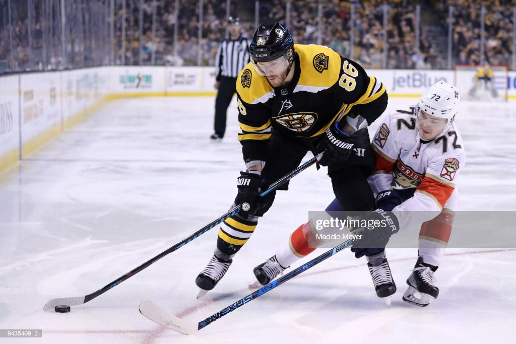 Frank Vatrano #72 of the Florida Panthers defends Kevan Miller #86 of the Boston Bruins during the third period at TD Garden on April 8, 2018 in Boston, Massachusetts. The Panthers defeat the Bruins 4-2.