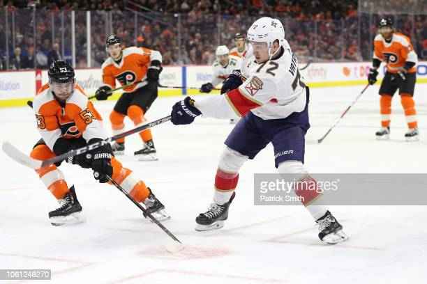 Frank Vatrano of the Florida Panthers shoots in front of Shayne Gostisbehere of the Philadelphia Flyers during the first period at Wells Fargo Center...