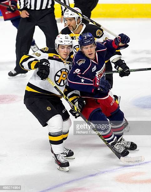 Frank Vatrano of the Providence Bruins checks Henrik Samuelsson of the Springfield Falcons during an American Hockey League game at the Dunkin'...